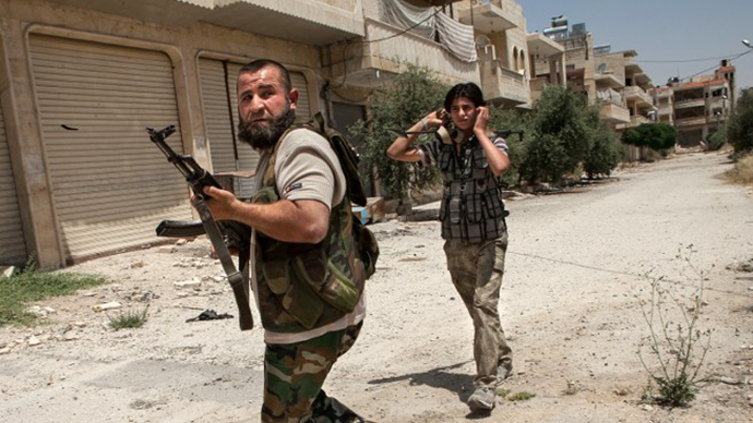 "Syrian rebel fighters belonging to the ""Martyrs of Maaret al-Numan"" battalion leave their position after a range of shootings on June 13, 2013. (AFP Photo / Daniel Leal-Olivas)"