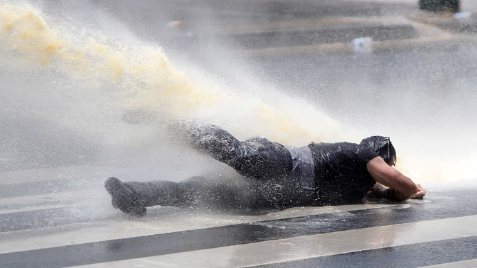 A protester is being sprayed by the police's water cannon during a demonstration at Kizilay square in central Ankara June 16, 2013. (Reuters/Dado Ruvic)