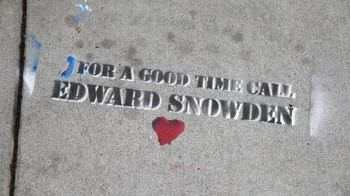 Graffiti that is sympathetic to NSA leaker Edward Snowden is seen stenciled on the sidewalk on June 11, 2013 in San Francisco, California (AFP Photo /  Justin Sullivan)