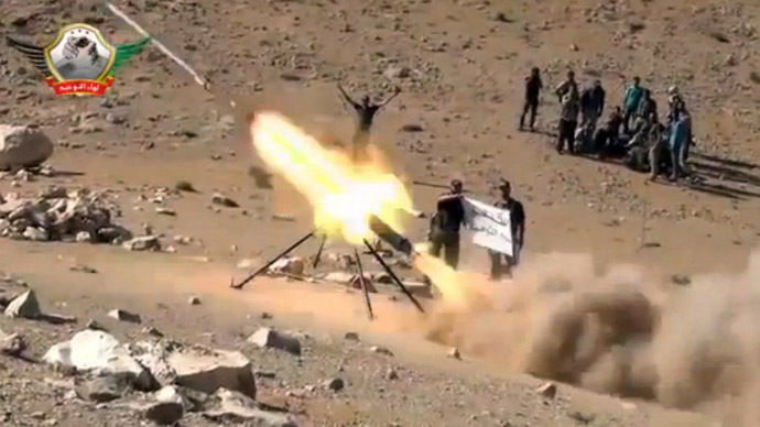 An image grab taken from a video uploaded on YouTube on May 29, 2013 allegedly shows members of the Al-Tawhid brigade firing missiles. (AFP Photo)