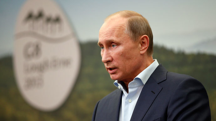 Russia's President Vladimir Putin speaks during a media conference at the conclusion of the G8 summit at the Lough Erne resort near Enniskillen in Northern Ireland on June 18, 2013.(AFP Photo / Matt Dunham)