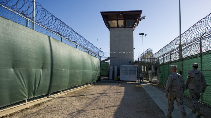 "This image reviewed by the US military, show two members of the military walking out of the ""Camp Six"" detention facility of the Joint Detention Group at the US Naval Station in Guantanamo Bay, Cuba (AFP Photo/Jim Watson)"