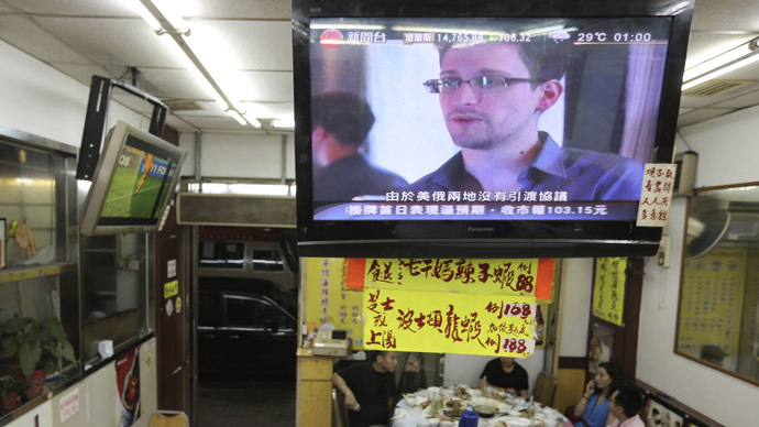 Edward Snowden, a former contractor at the National Security Agency (NSA), is seen during a news broadcast on television at a restaurant in Hong Kong June 26, 2013.  (Reuters)