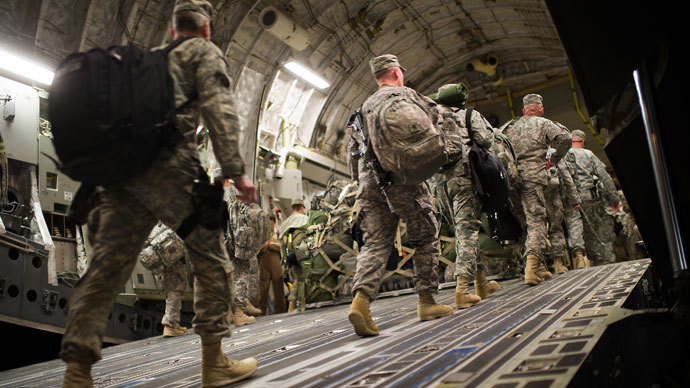 US soldiers board the last C17 aircraft carrying US troops out of Iraq at Camp Adder on the outskirts of the southern Iraqi city of Nasiriyah.(AFP Photo / Martin Bureau)