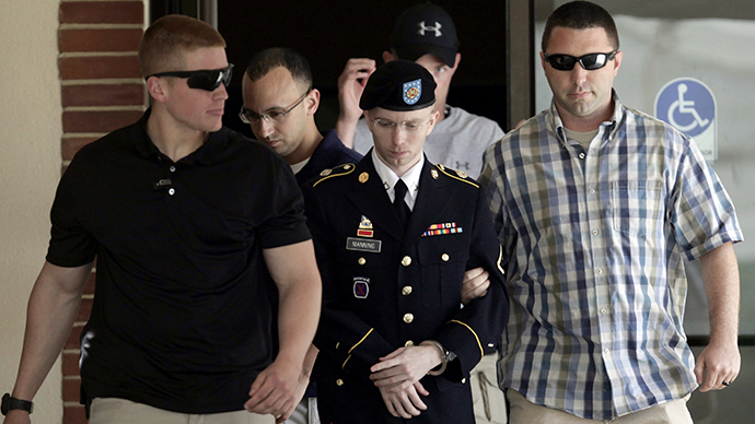 U.S. Army Private First Class Bradley Manning (C) is escorted from the courtroom after a day of his court martial trial at Fort Meade, Maryland June 25, 2013. (Reuters / Yuri Gripas)