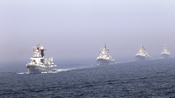 (FILE) Chinese missile destroyers navigate during the fleet's review of the China-Russia joint naval exercise in the Yellow Sea April 26, 2012. (Reuters / China Daily)