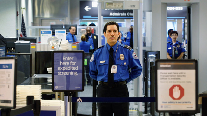 A TSA agent waits for passengers to use the TSA PreCheck lane being implemented by the Transportation Security Administration at Miami International Airport (Joe Raedle/Getty Images/AFP)