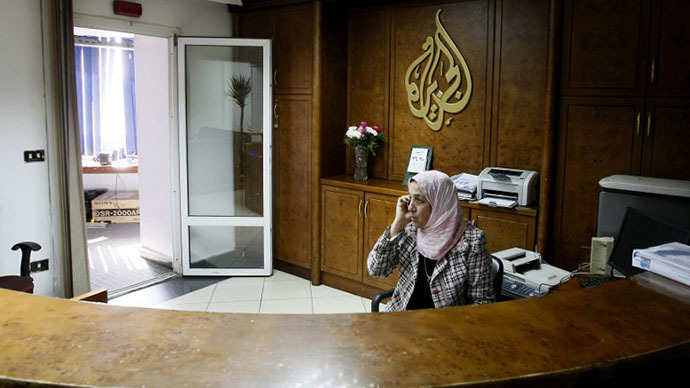 An Al-Jazeera employee talks on the phone at the pan-Arab television channel's bureau in Cairo. (AFP Photo / Mohammed Abed)