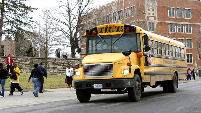 Students prepare to leave on a school bus in Kansas City, Missouri. (AFP Photo / G. Newman Lowrance)