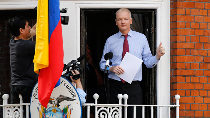 Wikileaks founder Julian Assange gestures as he prepares to speak from the balcony of Ecuador's embassy, where he is taking refuge in London (Reuters / Chris Helgren)