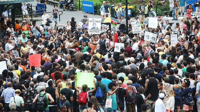 People gather at a rally honoring Trayvon Martin at Union Square in Manhattan on July 14, 2013 in New York City. (AFP Photo / Mario Tama)