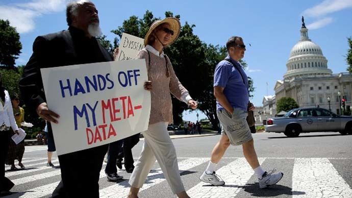 Protesters rally outside the U.S. Capitol against the NSA's recently detailed surveillance programs June 13, 2013 in Washington, DC. (AFP Photo / Getty Images / Win Mcnamee)