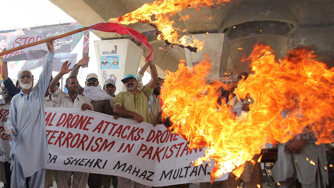 Pakistani protesters from the United Citizen Action torch a US flag against US drone attacks in the Pakistani tribal areas during a protest in Multan on July 14, 2013.(AFP Photo / S.S Mirza)