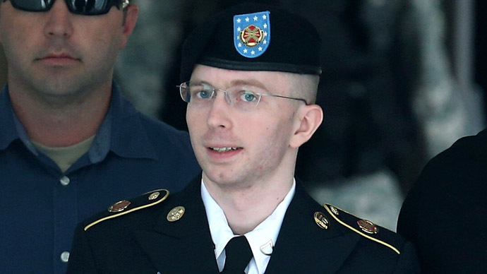 U.S. Army Private First Class Bradley Manning is escorted by military police as he leaves his military trial after he was found guilty of 20 out of 22 charges, July 30, 2013 Fort George G. Meade, Maryland.  (Mark Wilson/Getty Images/AFP)
