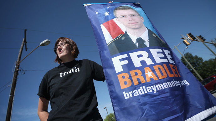 Emma Cape, a supporter of U.S. Army Pfc. Bradley E. Manning, holds a sign during a demonstration outside the main gate of Ft. Meade July 30, 2013 in Maryland. (Alex Wong/Getty Images/AFP)
