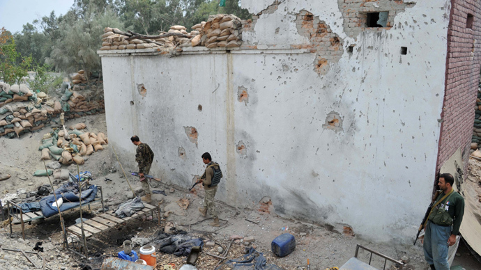 Afghan security personnel inspect a damaged police post following an airstrike in Bati Kot district in Nangarhar province on August 1, 2013 (AFP Photo / Noorullah Shirzada)