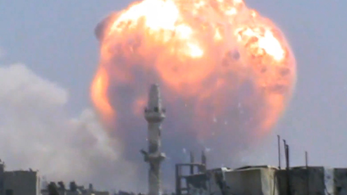 An image grab taken from a video uploaded on Youtube on August 1, 2013 allegedly shows fire billowing from buildings in Syria's central city of Homs following a blast in a regime ammunition dump which left tens dead (AFP Photo / Youtube)