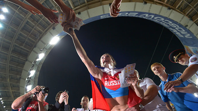 Russia's Elena Isinbayeva celebrates with fans after winning the women's pole vault final at the 2013 IAAF World Championships at the Luzhniki stadium in Moscow on August 13, 2013. (RIA Novosti / Ramil Sitdikov)