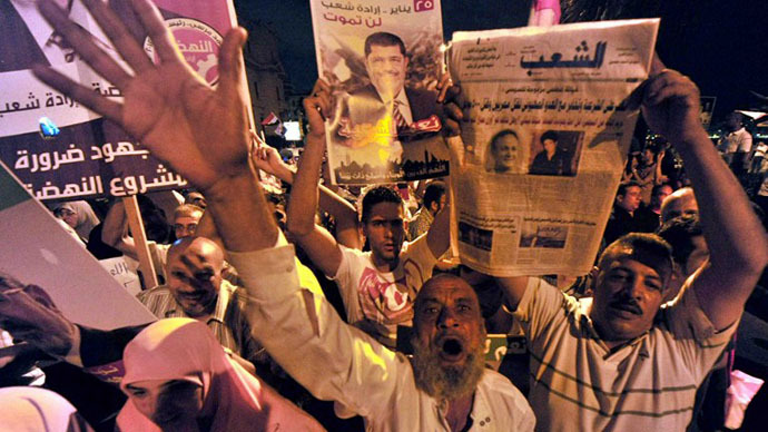 Muslim Brotherhood supporters shout slogans during a demonstration in the port city of Alexandria on August 13, 2013, against the former leader's overthrow by the military. (AFP Photo)