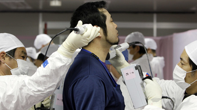 A worker screened for radiation as he enters the emergency operation center at Tokyo Electric Power Co. (TEPCO)'s tsunami-crippled Fukushima Daiichi nuclear power plant in Fukushima prefecture (Reuters/Issei Kato)