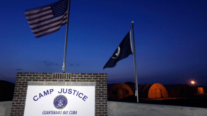 Flags fly above the sign for Camp Justice, the site of the US war crimes tribunal compound, at Guantanamo Bay US Naval Base in Cuba. (Reuters / Brennan Linsley)