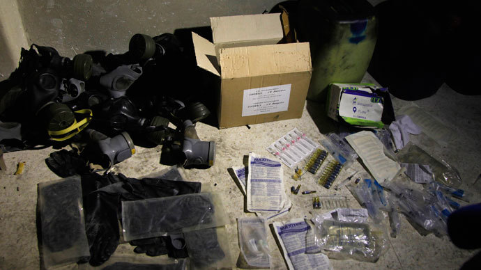 Chemical materials and gas masks are pictured in a warehouse at the front line of clashes between opposition fighters and government forces, during a guided tour by the Syrian Army in the Damascus suburb of Jobar August 24, 2013.(Reuters / Khaled al-Hariri)