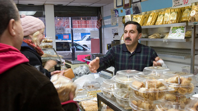A man serving customers in a Syrian bakery in New York (Photo from Flickr.com)