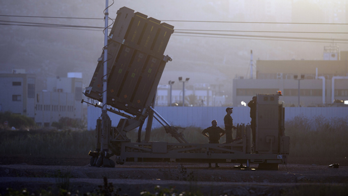 "Israeli soldiers check an ""Iron Dome"" battery, a short-range missile defence system (AFP Photo)"