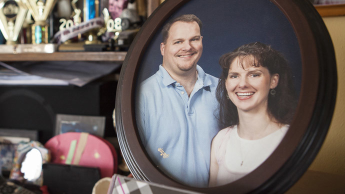 A framed photo of Todd and Melissa Puchalla sits on top of the piano in their home in Kiel, Wisconsin May 8, 2103. (Reuters/Sara Stathas)