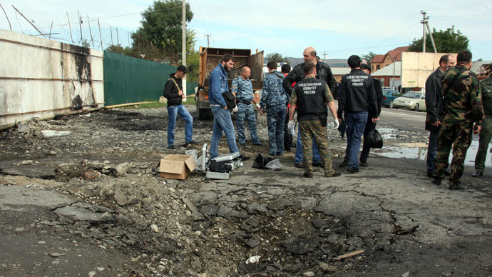 Police at the site of an explosion by the local police precinct in the village of Sernovodsk, Sunzhensky District, Chechen Republic. On September 16, three police officers were killed and four wounded in a suicide attack targeting the precinct.(RIA Novosti / Said Tcarnaev)