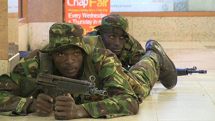 An image grab taken from AFP TV shows Kenyan troops taking position on September 21, 2013 inside the Westgate mall in Nairobi. (AFP Photo / Nichole Sobecki)