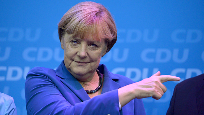 German Chancellor and candidate for the Christian Democratic Union (CDU) Angela Merkel reacts as she addresses supporters after exit polls were broadcast on television in Berlin on September 22, 2013, after the German general elections. (AFP Photo / Odd Andersen)