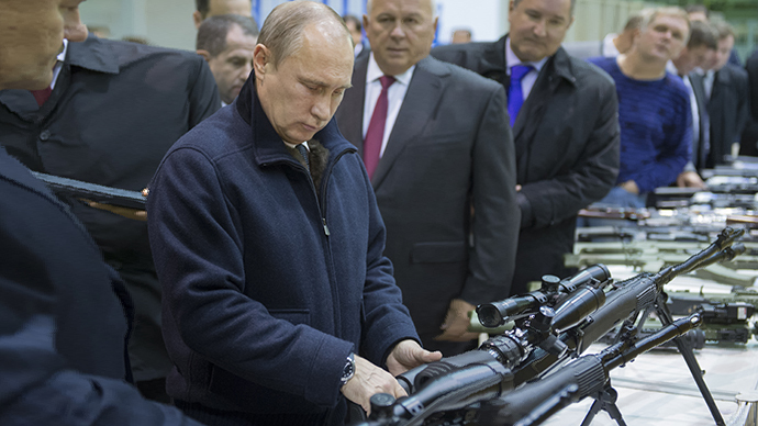 Russian President Vladimir Putin reviews examples of the small arm weapons during a working visit to OJSC 'Kalashnikov Concern' in Izhevsk. (Sergey Guneev / RIA Novosti)