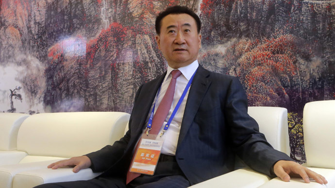 Wang Jianlin, chairman of Chinese property developer Dalian Wanda Group, sits in a meeting room as he arrives for the launch ceremony of the Qingdao Oriental Movie Metropolis on the outskirts of Qingdao, Shandong province, September 22, 2013. (Reuters/Jason Lee)