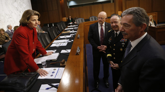US Senate (Select) Intelligence Committee Chairwoman Dianne Feinstein (D-CA)(L) speaks with Director of National Intelligence James Clapper (2nd L), National Security Agency Director General Keith Alexander and Deputy Attorney General James Cole (R) before they testify at a Senate Intelligence Committee hearing the Foreign Intelligence Surveillance Act legislation on Capitol Hill in Washington, September 26, 2013. (Reuters/Jason Reed)