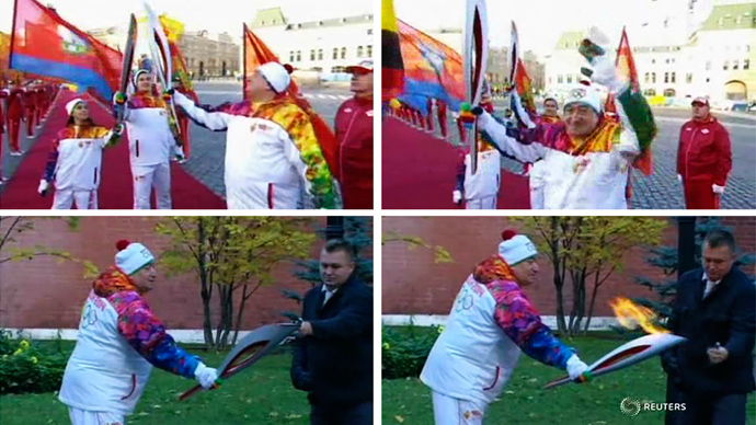 Still images taken from video show torchbearer Karapetyan receiving the Olympic torch and an unidentified man relighting the torch with a lighter,Moscow,October 6,2013 (Reuters/Reuters TV)
