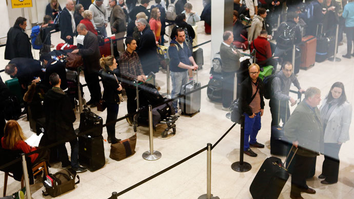 British Airways passengers queue for customer services after flights were delayed and cancelled at Heathrow after short haul services were cut due to an emergency landing in London.(Reuters / Olivia Harris)