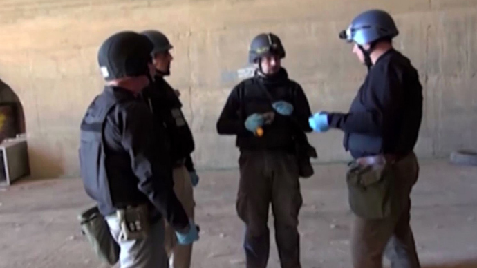 Inspectors from the Organisation for the Prohibition of Chemical Weapons (OPCW) at work at an undisclosed location in Syria (AFP Photo / Syrian Television)