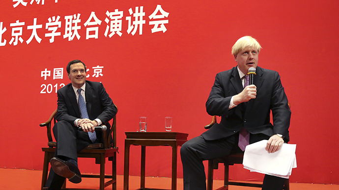 Mayor of London Boris Johnson (R) talks as Britain's Chancellor of the Exchequer, George Osborne, looks on during their visit to Peking University in Beijing, October 14, 2013. (Reuters / China Daily)