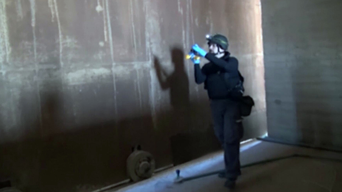 An image grab taken from Syrian television on October 10, 2013 shows an inspector from the Organisation for the Prohibition of Chemical Weapons (OPCW) at work at an undisclosed location in Syria. (AFP Photo)
