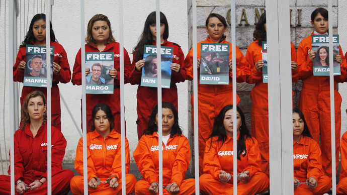 Greenpeace activists protest inside a mock prison cell, in support of fellows activists who were detained on the boat Arctic Sunrise, during a rally at the Mahatma Gandhi monument in Mexico City October 18, 2013.  (Reuters/Edgard Garrido)