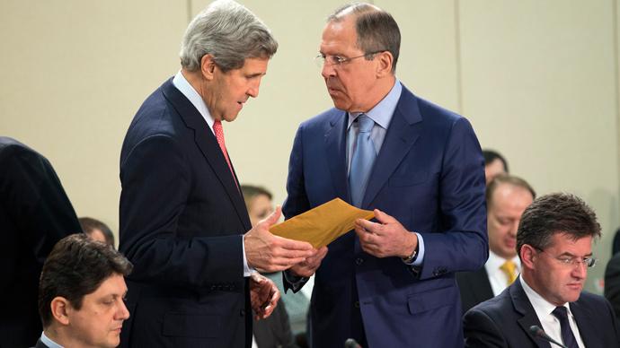 Russian Foreign Minister Sergei Lavrov (R) talks with US Secretary of State John Kerry before the start of the NATO-Russia Council meeting at the NATO Headquarters in Brussels on April 23, 2013 (AFP Photo / Evan Vucci)