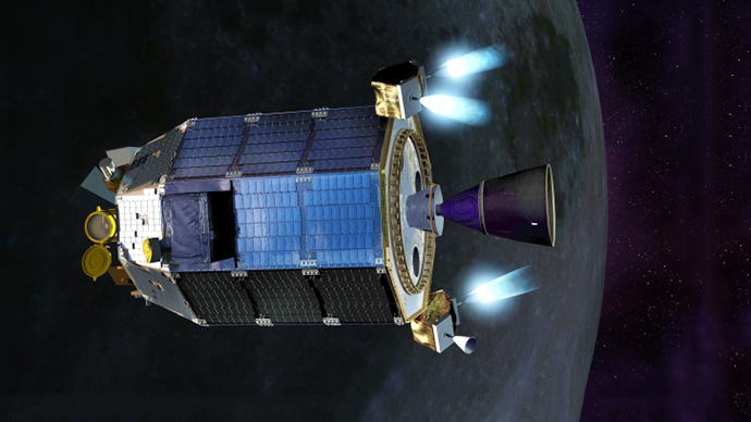 An artist's concept of NASA's Lunar Atmosphere and Dust Environment Explorer (LADEE) spacecraft firing its maneuvering thrusters in order to maintain a safe altitude as it orbits the moon. (Image Credit:  NASA Ames / Dana Berry)