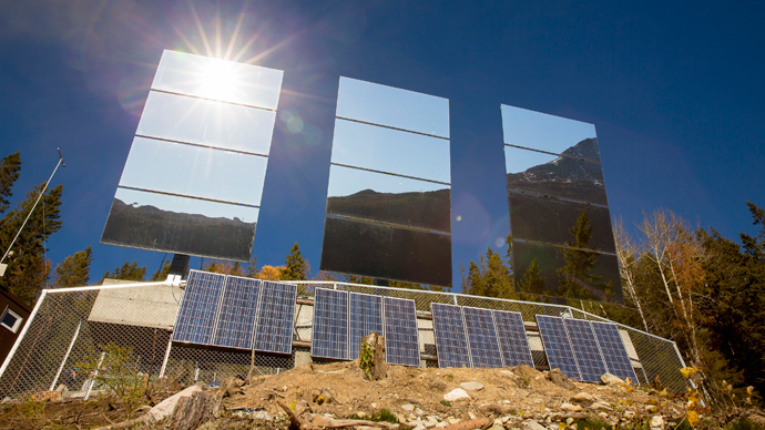 Giant mirrors erected on a mountainside reflect sunlight into the Norwegian industrial town of Rjukan (Reuters / Tore Meek / NTB Scanpix)