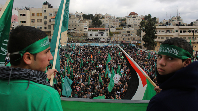 ARCHIVE PHOTO: Hamas supporters wave flags during a rally in the West Bank city of Hebron (Reuters / Ammar Awad)