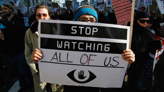 "A demonstarator holds up a sign at the ""Stop Watching Us: A Rally Against Mass Surveillance"" march near the U.S. Capitol in Washington, October 26, 2013. (Reuters / Jonathan Ernst)"
