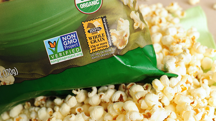 A label on a bag of popcorn indicates it is a non-GMO food product, in Los Angeles, California,  October 19, 2012. (AFP Photo / Robyn Beck)