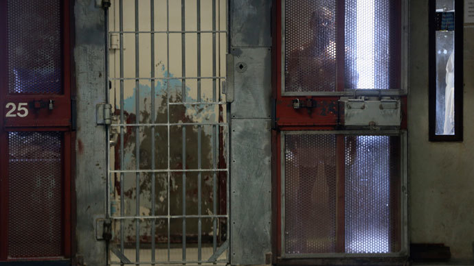 An inmate looks out from his cell in the Secure Housing Unit (SHU) at Corcoran State Prison in Corcoran, California October 1, 2013.(Reuters / Robert Galbraith)