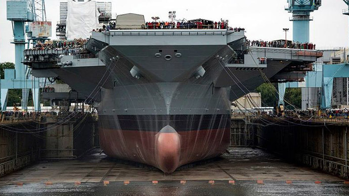 CVN 78 (Gerald R Ford) at the shipyard during the initial filling of the drydock. (Photo from Wikipedia.org)