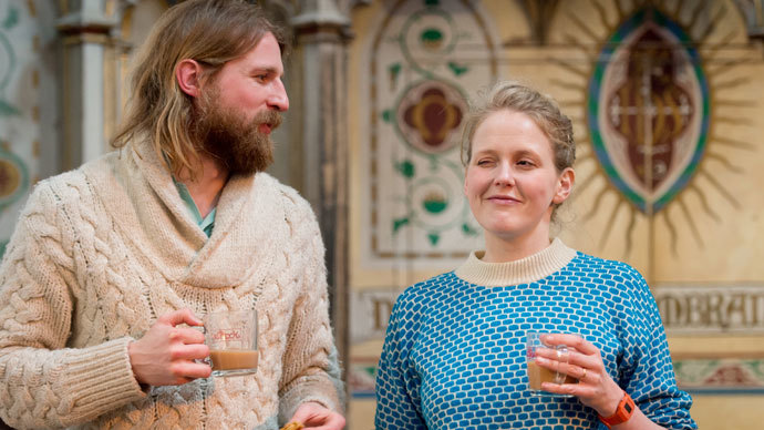 British comedians Sanderson Jones (L) and Pippa Evans (R) co-founders of The Sunday Assembly, an atheist service held at a converted church, pose for pictures after a service in north London.(AFP Photo / Leon Neal)